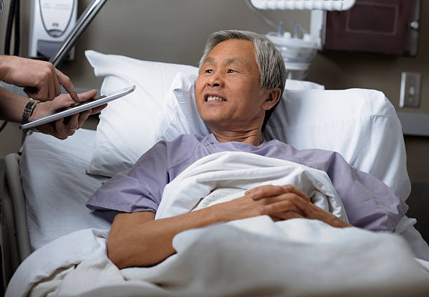 Mature male patient in hospital. stock photo