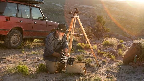 Mature Male Photographer with Medium Format Camera
