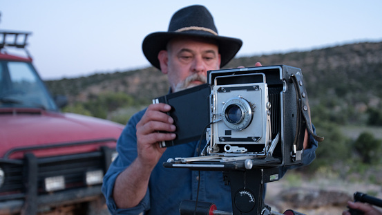 Mature Male Photographer with Medium Format Camera