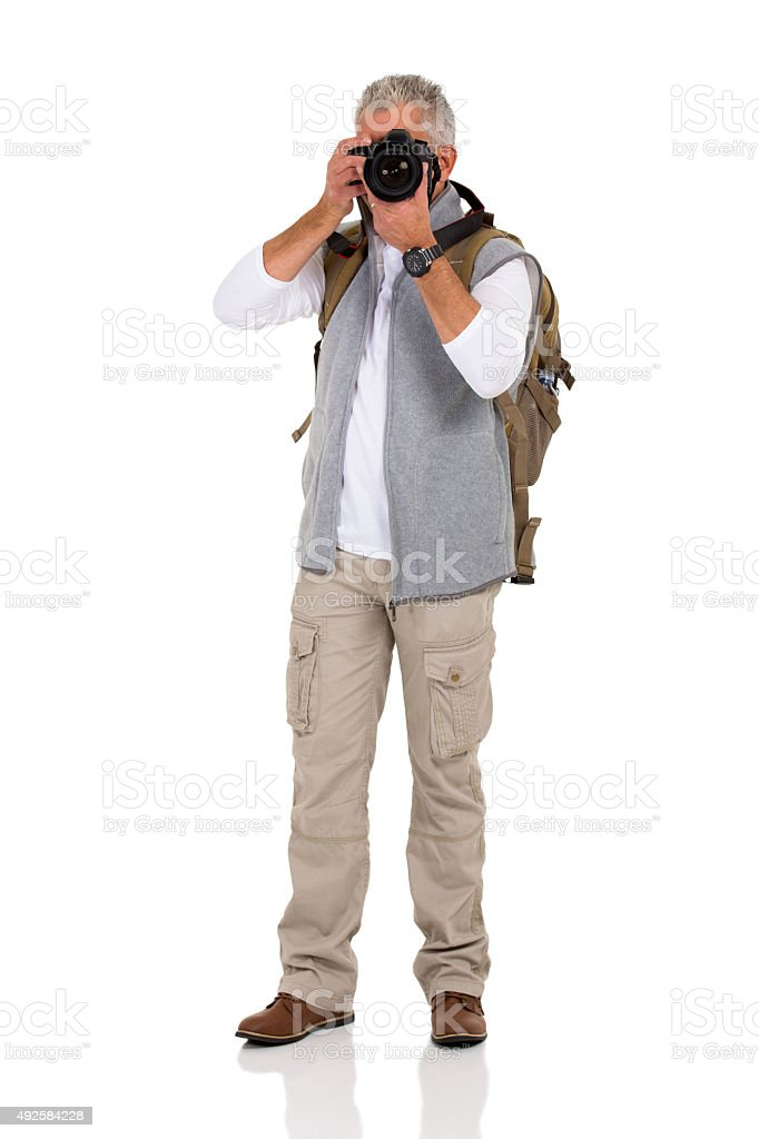 mature male tourist taking pictures stock photo