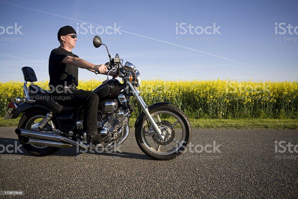 Mature man and his bike royalty-free stock photo