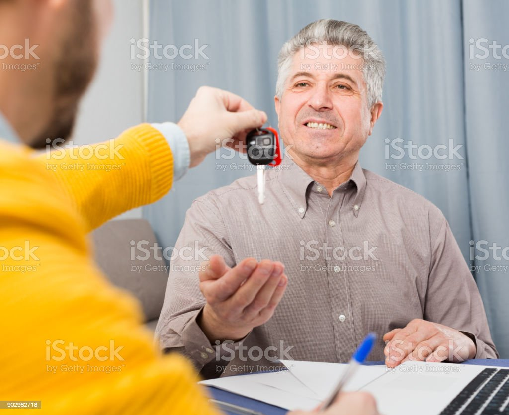 Mature man and manager  contract car lease stock photo