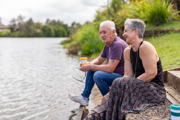Mature Man and Woman by a River stock photo