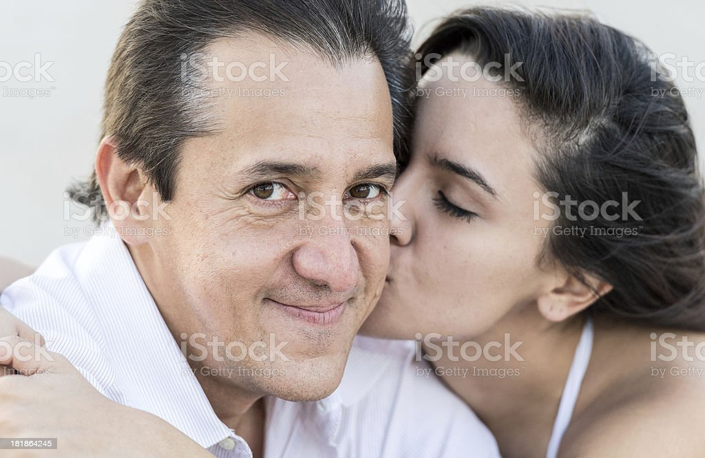 Mature man and young woman stock photo