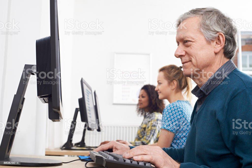 Mature Man Attending Computer Class stock photo