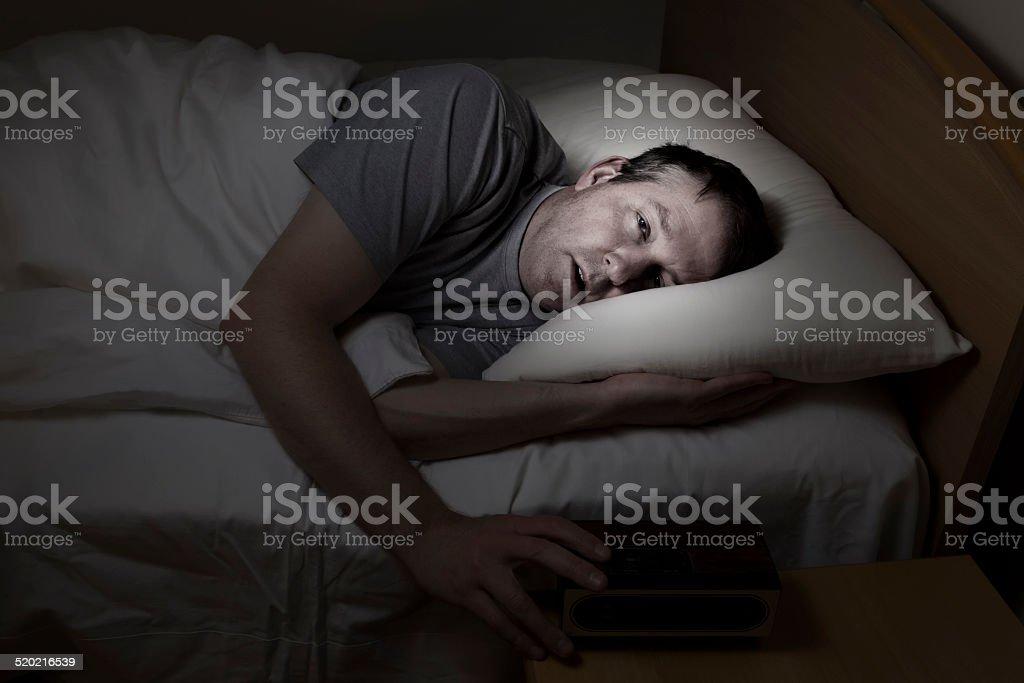 Mature man cannot get to sleep stock photo