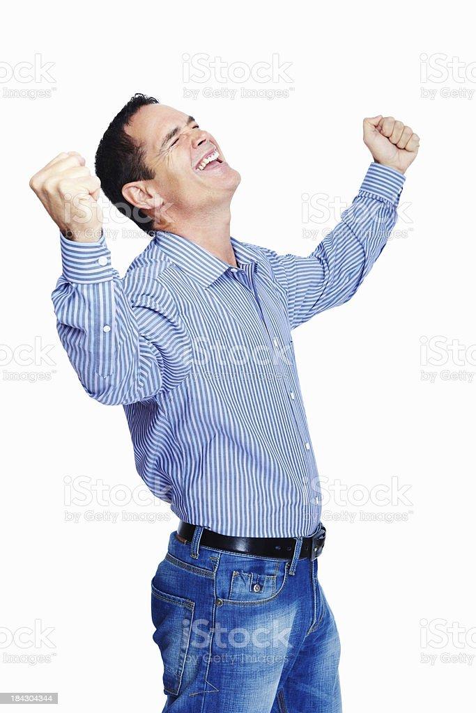 Mature man celebrating victory royalty-free stock photo