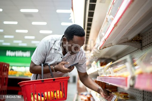 istock Mature man choosing products in supermarket 1184045780
