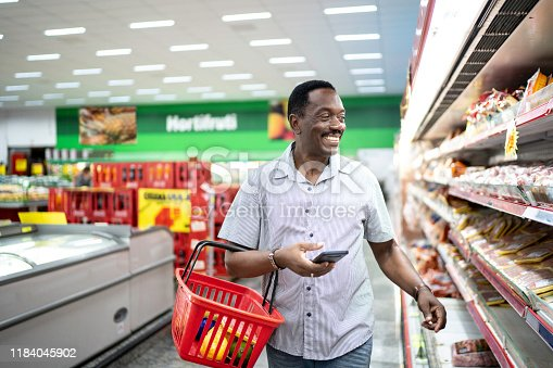 istock Mature man choosing products in supermarket 1184045902