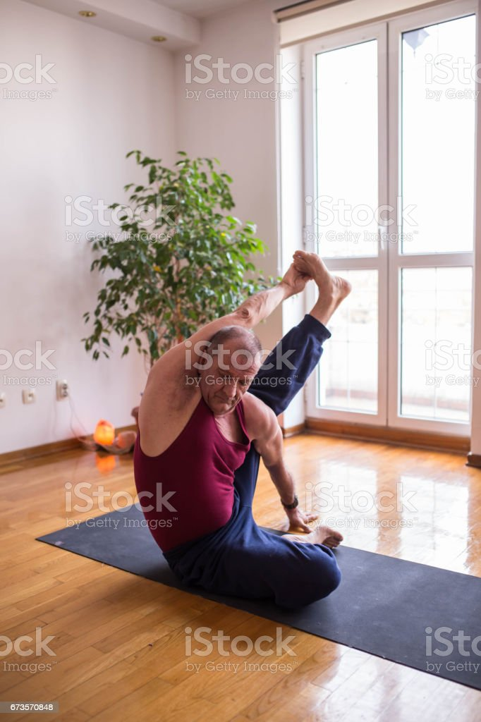 Mature Man Doing Yoga Difficult Poses Royalty Free Stock Photo
