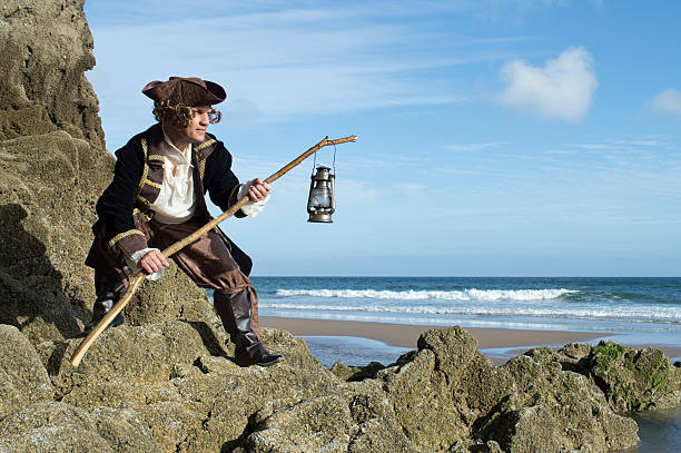 Mature man dressed as a pirate in a traditional costume stock photo