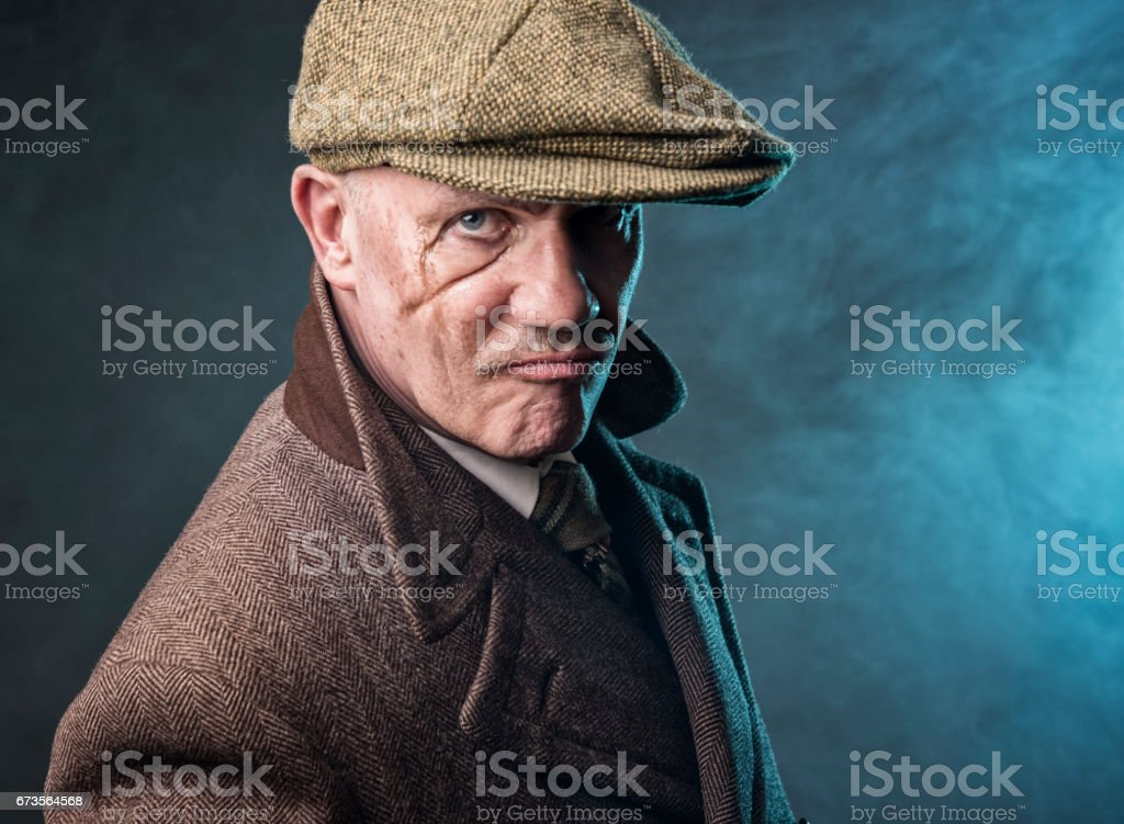 Mature man dressed as an English 1920s gangster stock photo