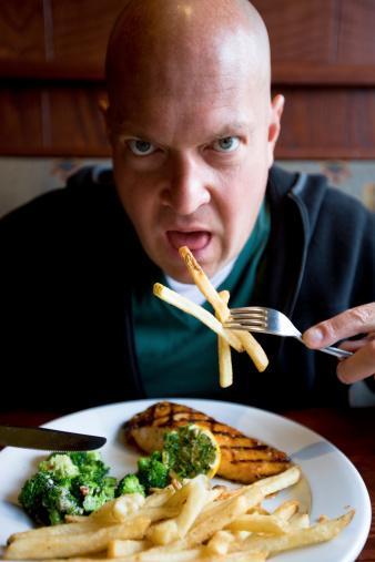 Mature Man Eating Grilled Salmon And French Fries-foton och fler bilder på 40-49 år