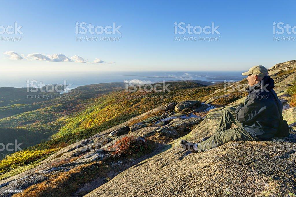 Mature Man Enjoying View from Mountain stock photo