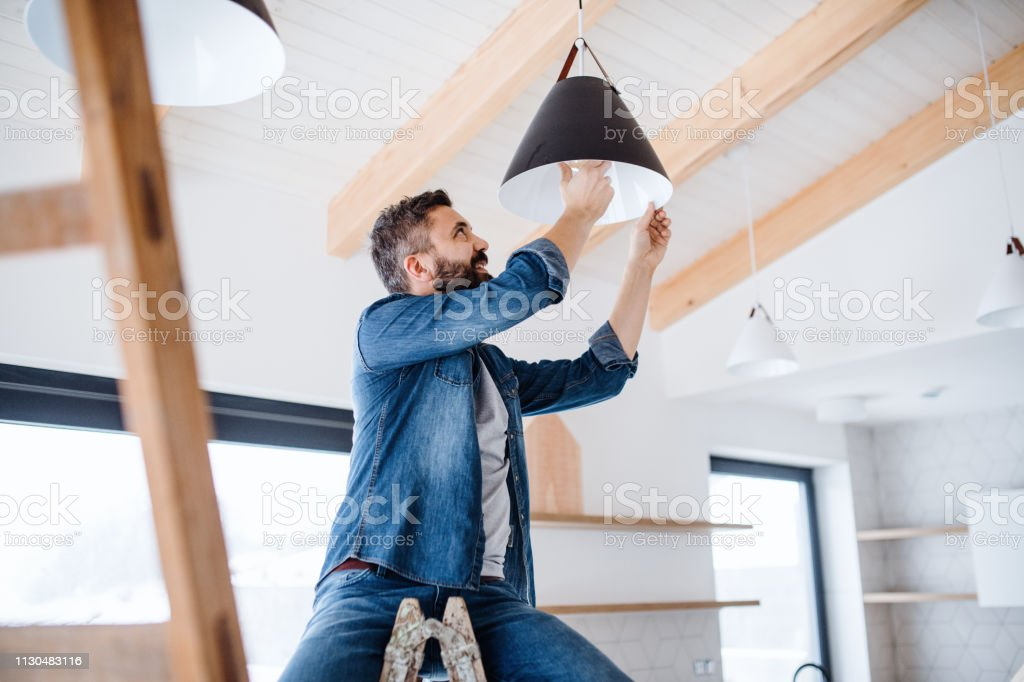 A mature man furnishing new house, a new home concept. stock photo