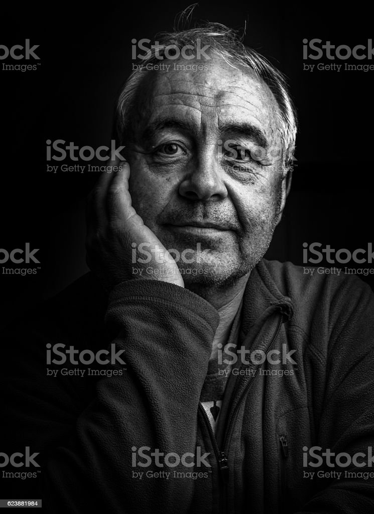 Mature man gritty portrait close-up stock photo
