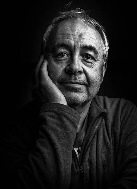 Mature man gritty portrait close-up stock photo