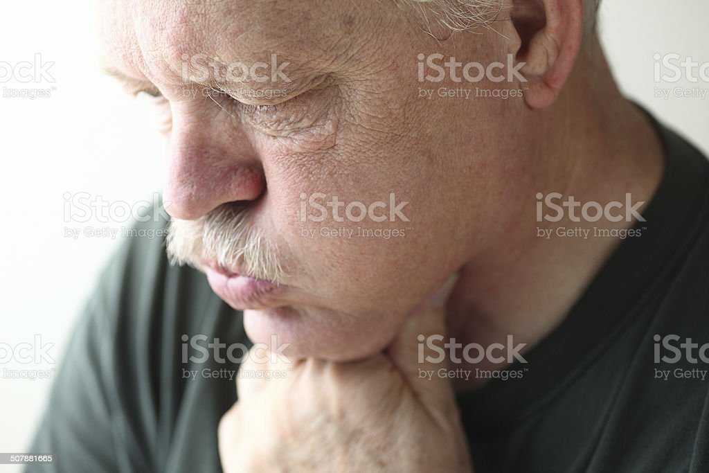 Mature man has acid reflux stock photo