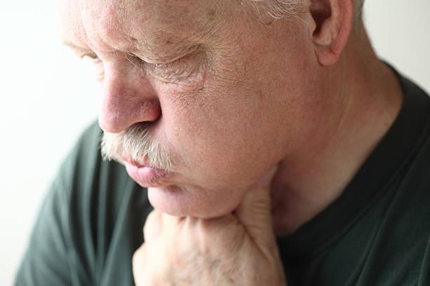 Mature man has acid reflux stock photo