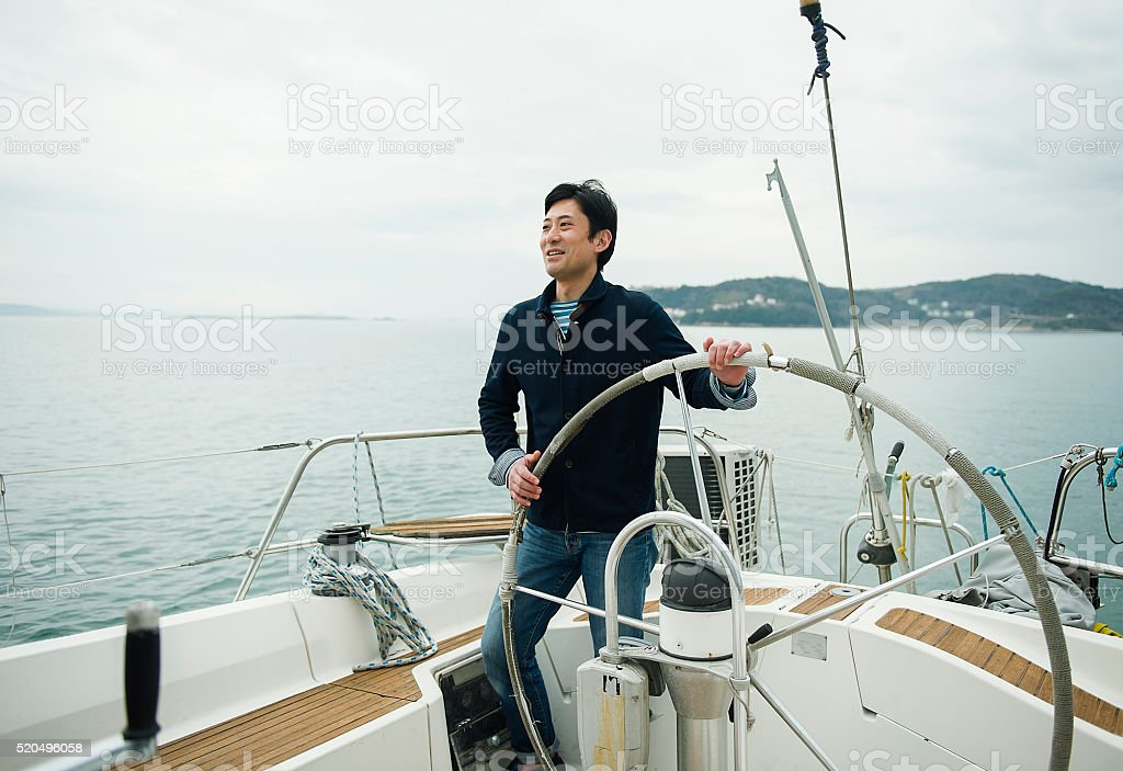 Mature man has been sailing the yacht stock photo