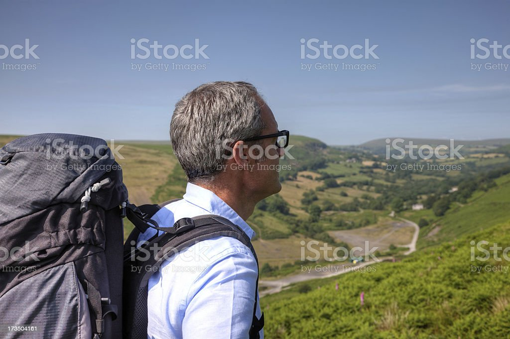 Mature man hiking in countryside royalty-free stock photo