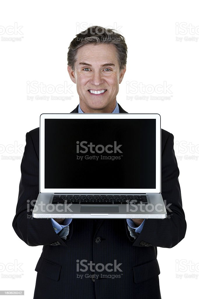 Mature man holding a computer royalty-free stock photo