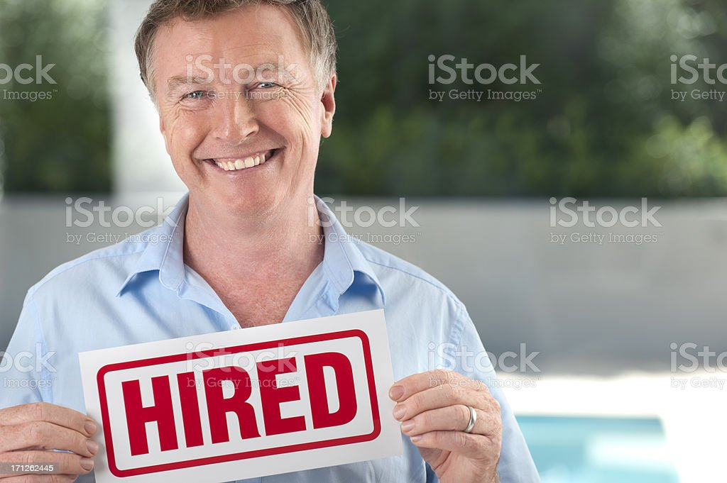 Mature man holding a hired sign stock photo