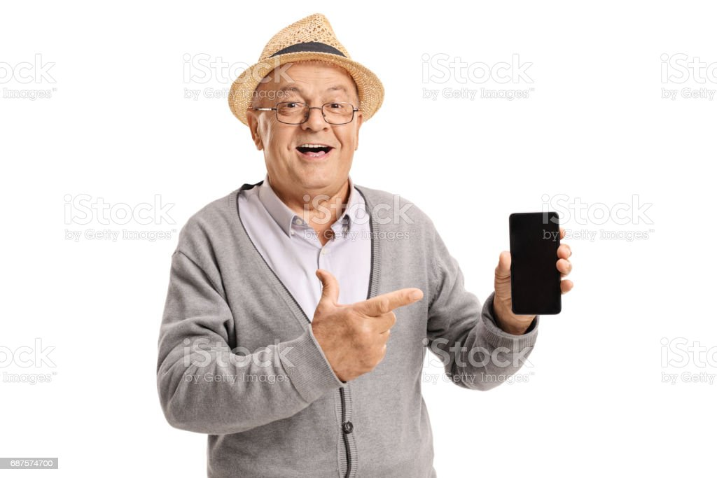 Mature man holding a phone and pointing stock photo