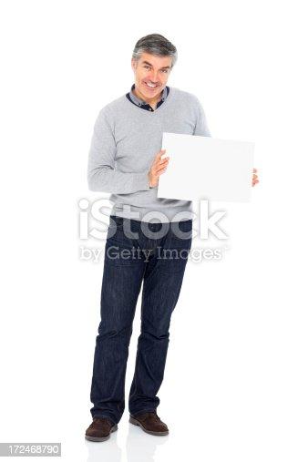 istock Mature man holding blank billboard on white 172468790