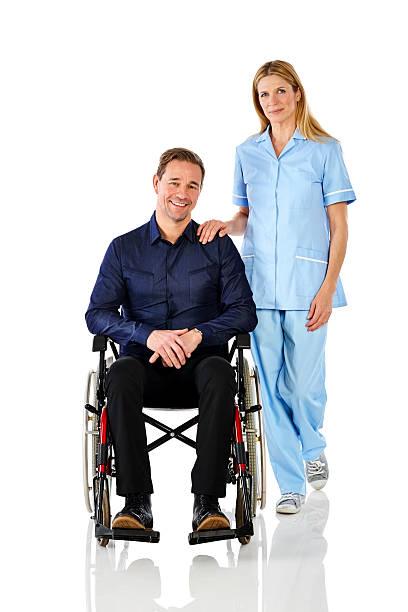 mature man in a wheelchair with female nurse - hospital studio bildbanksfoton och bilder