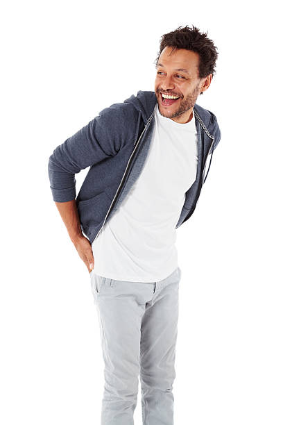 Mature man in casuals looking away laughing stock photo