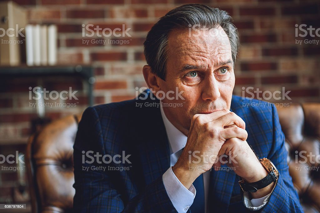 Mature man in deep desperation stock photo