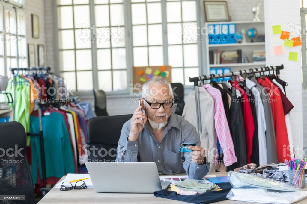 Mature Man In Fashion Studio Using Credit Card Stock Photo Download Image Now Istock