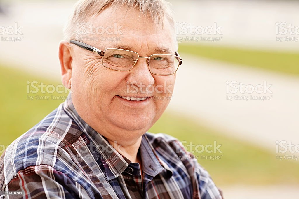 Mature man in glasses outdoors stock photo
