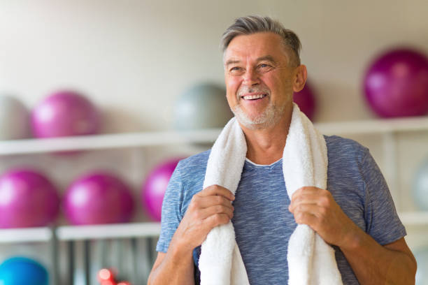 Mature man in health club stock photo