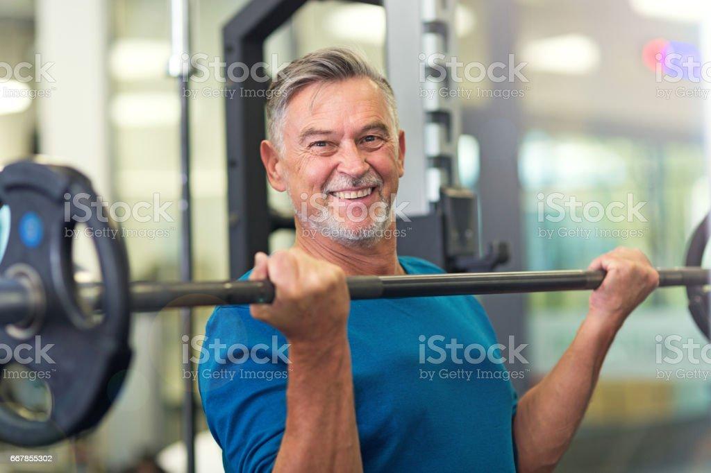 Mature man in health club stock photo