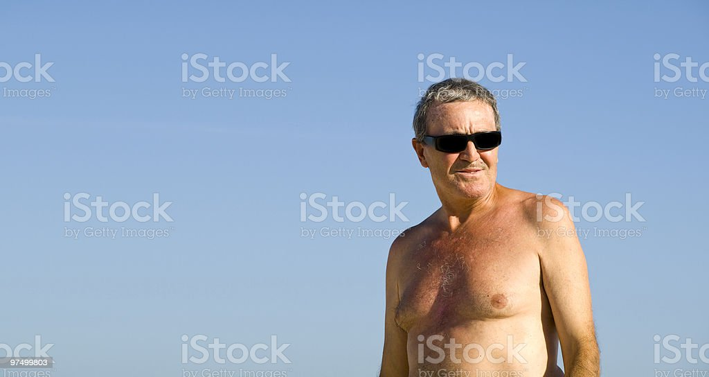 Mature man in the beach royalty-free stock photo