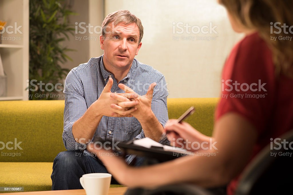 mature man in therapy stock photo