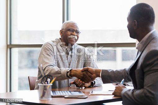 After a successful interview, a mature adult man is hired to handle outreach and promotions to senior adults in the community.