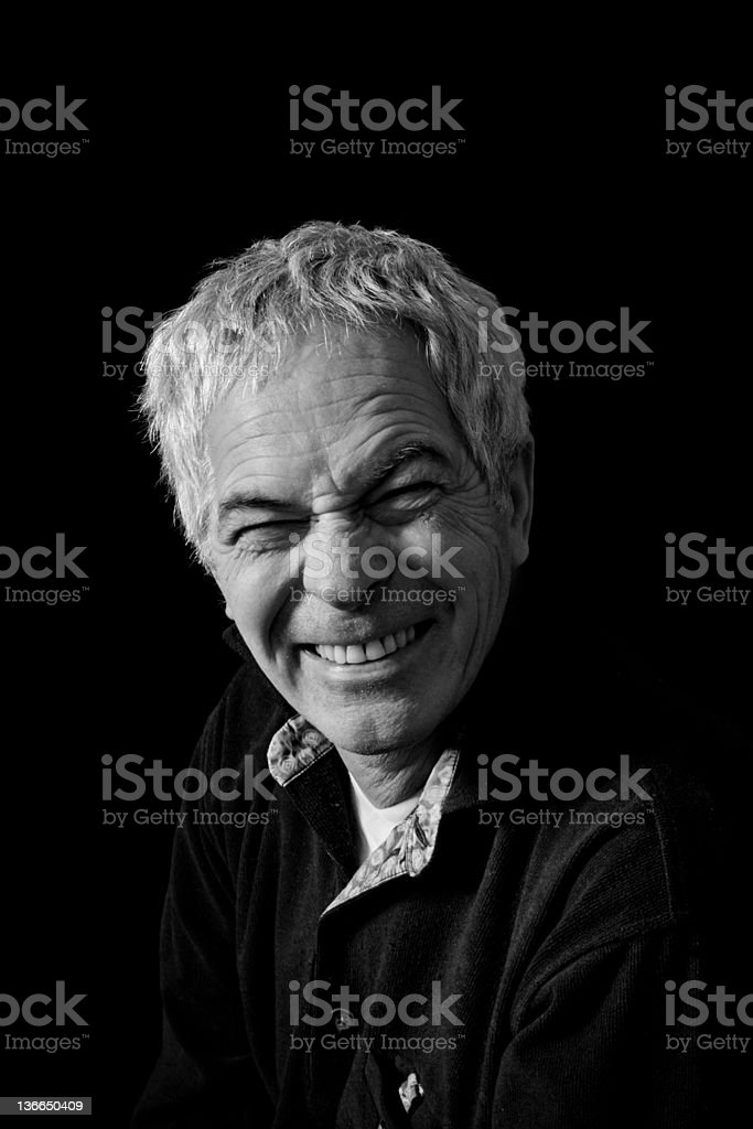 Mature man is making funny smile stock photo