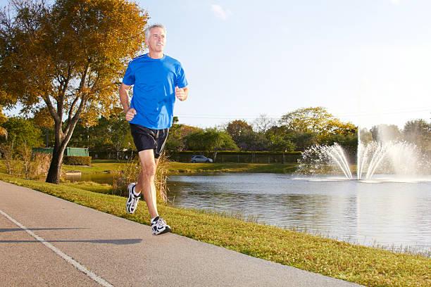 Mature Man Jogging stock photo