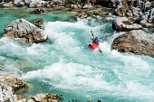 Mature Man Kayaking In White Water Of River Soca