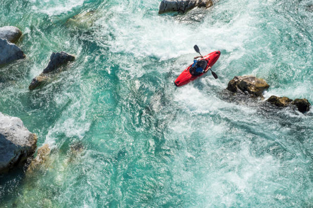mature man kayaking on  river soca rapids - high angle view - rischio foto e immagini stock
