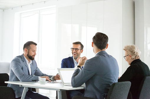 Mature Man Laughing In Meeting Stock Photo - Download Image Now