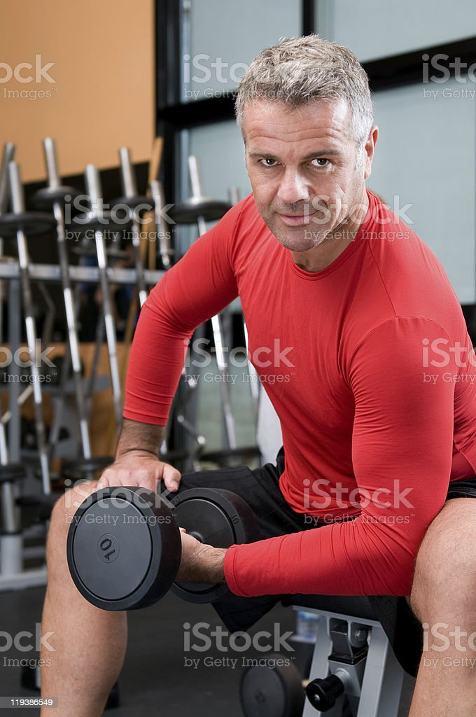 Mature man lifting dumbbells royalty-free stock photo