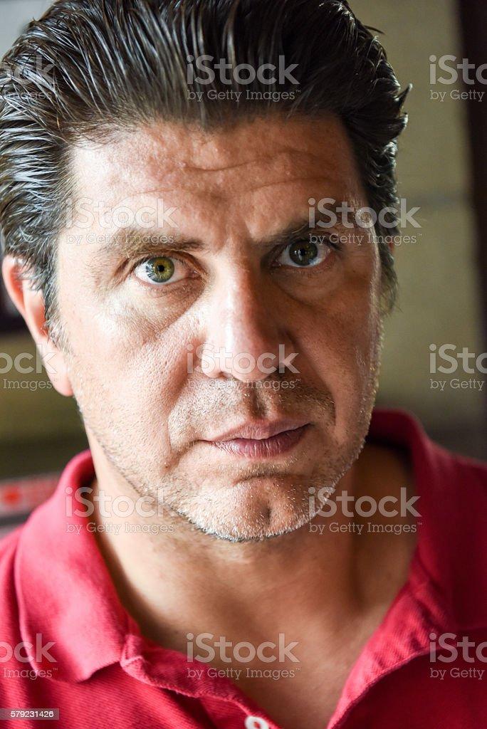 Mature man looking at the camera stock photo