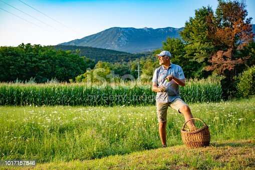 Mature Man Looking at the Fields After Harvesting.