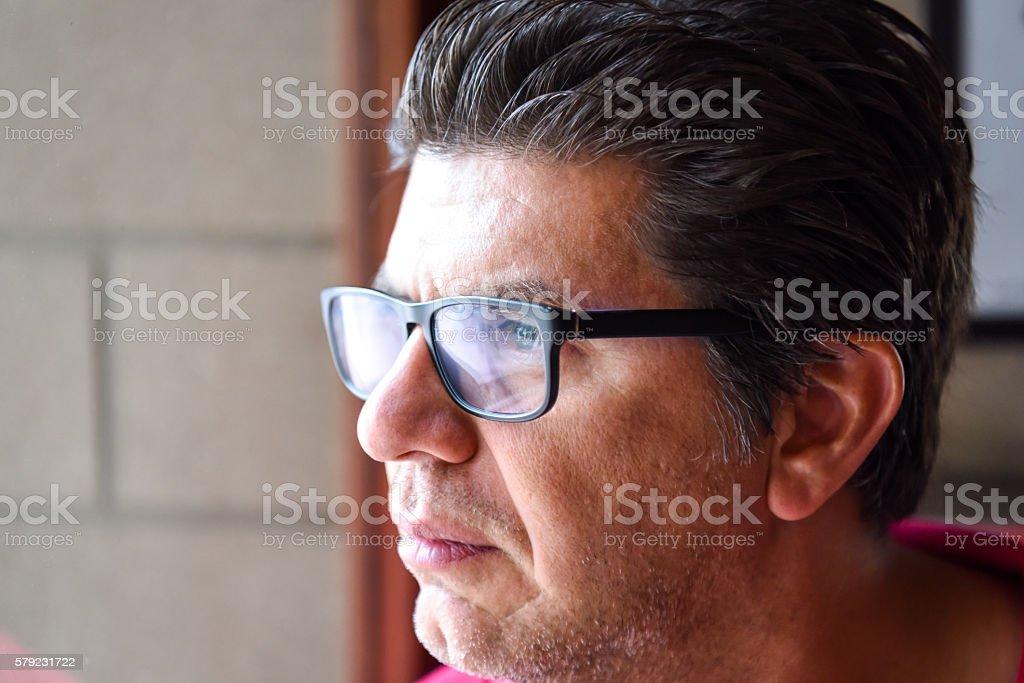 Mature man looking away stock photo