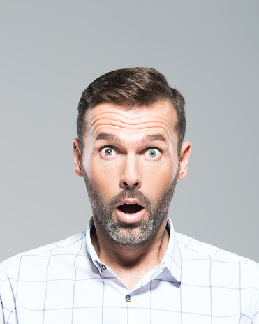 Mature Man Looking Shocked Stock Photo - Download Image Now