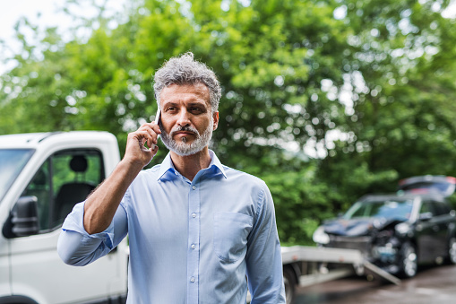 istock Mature man making a phone call after a car accident. Copy space. 1020547664